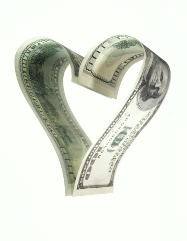 Money shaped into a heart