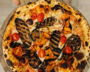 Pizza with squash and tomatoes