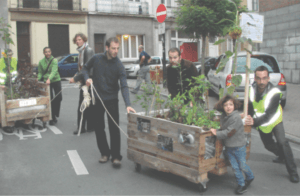 people moving a planter