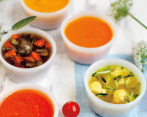 Five bowls of different types of soup