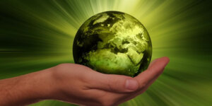 hand holding a green earth