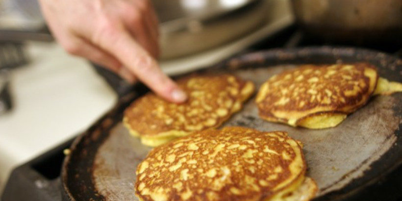 Three pancakes on a griddle