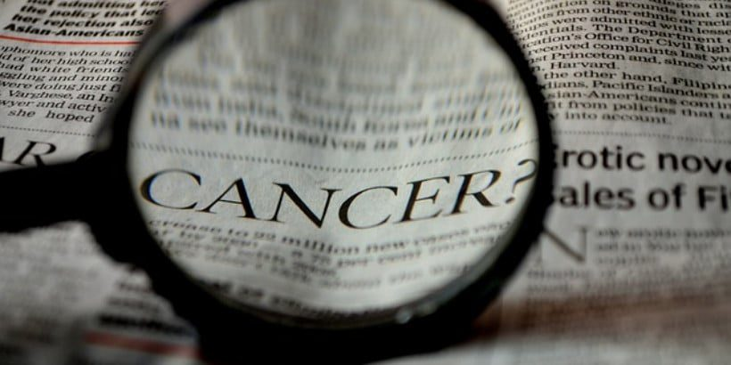 newspaper with the word cancer