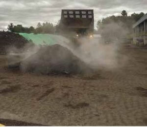 Water truck adding moisture to compost
