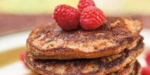 plantain blender pancakes with raspberries on top