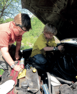 kids working on a car
