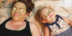 woman and child wearing an okra facemask