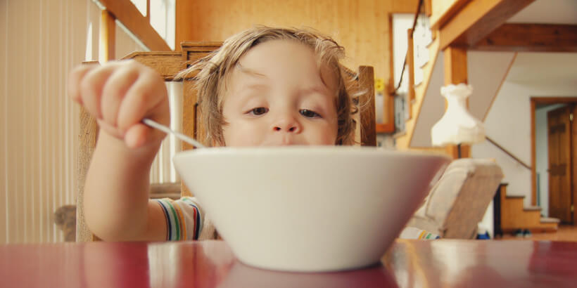 kid eating out of a bowl